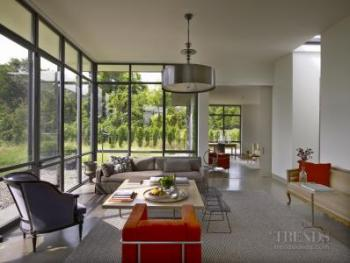 Country house with formal symmetry, glass walls, steel windows, large fireplace