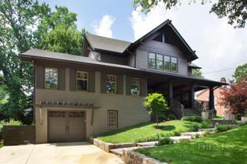 Whole-house remodel in Craftsman style with strong colors, exposed rafters, front porch