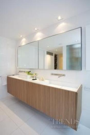 Resort-style bathroom with freestanding tub, large skylights, glass wall and bamboo screen