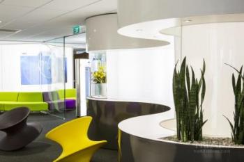 Contemporary office fit-out has dropped ceiling, acrylic screens, breakout area