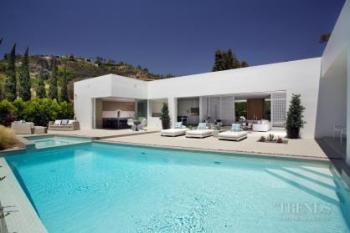 Mid-century Modern house makeover with white exterior opens to pool terrace
