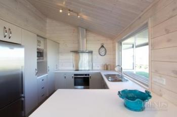Lockwood Nelson show home with solid blonded timber interior and long veranda