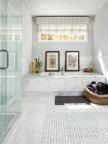 Traditional white bathroom with Carrara marble vanity tops, marble floor