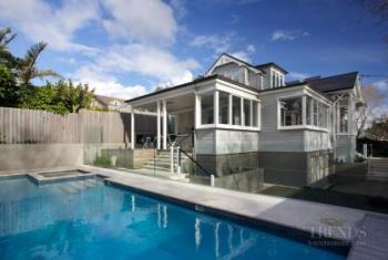 Villa renovation with new pool, basement garage, sun porch, dormer window, bay window