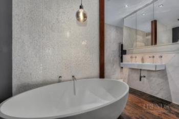 Opening the bathroom to the bedroom creates an airy, inviting master suite