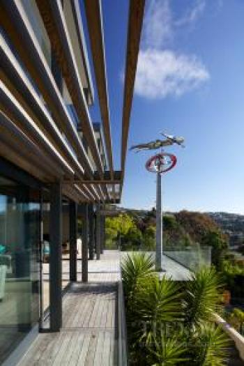 Hillside home in steel and glass with views, long decks and large living spaces