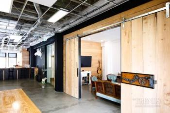 Raw materials and exposed services give design company industrial chic