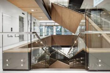 Medical research institute with centralised services, sculptural staircase