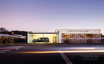 Contemporary funeral home designed as series of small linked volumes