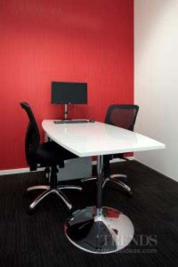 DKW Personnel office designed by Interiors @ OfficeMax has custom office furniture in red, white, chrome and black.