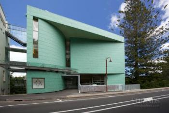 Contemporary art gallery beside Lopdell House in Titirangi with copper-green aluminium cladding