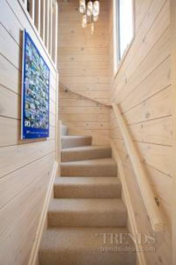 Lockwood beach house with solid blonded timber walls, raked ceiling, large deck