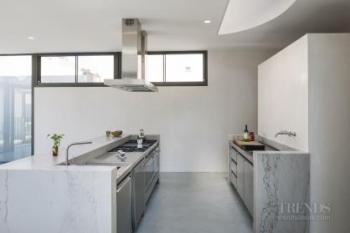 Kitchen renovation provides contemporary design, with three stainless steel workstations