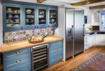 Mediterranean Style Kitchen With Transitional White Cabinets, Decorative  Tile Backsplash