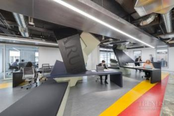Loft-style office space with geometric design, sculptural furniture, activity-based working