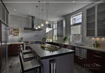 Contemporary kitchen design with cordial cherry cabinets, aluminum overhead cabinets