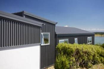 New Christchurch house on steep hill designed by Archimetrix to maximise sea views
