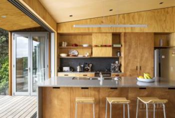 Contrasting plywood on walls, cabinets and ceilings in new holiday home