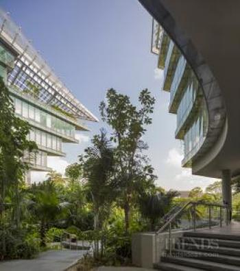 Contemporary horseshoe-shaped office building in Singapore with dramatic curved facade and jagged ends