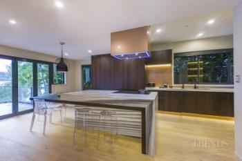 Striped marble island and benchtops in contemporary kitchen by Mal Corboy. Image: 5