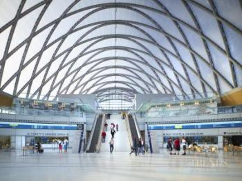 ARTIC transit hub Anaheim, has diagrid of steel arches supporting lightweight ETFE pillows