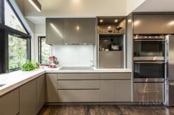 Contemporary new kitchen with warm neutral cabinets and quartz benchtops with suede finish
