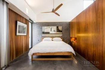 Contemporary master suite with privacy wall separating spaces