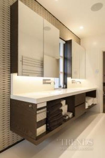 Contemporary master bathroom with textural tiles, freestanding bathtub