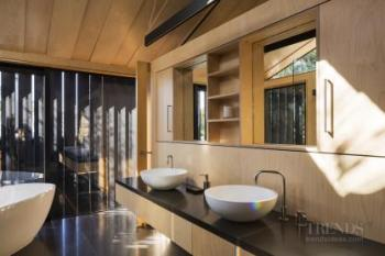 Yellow birch ply walls feature in contemporary new house by the beach
