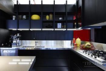 Warehouse apartment conversion with sleek kitchen in dark timber veneer