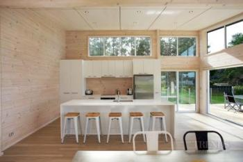 Lockwood holiday home at Snells Beach freatures custom design, solid blonded wood walls