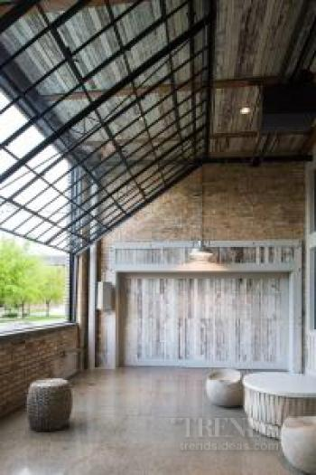 City warehouse loft conversion with exposed timber structural columns, brickwork