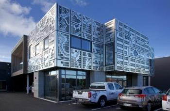 New Christchurch building for Corbel Construction features a perforated aluminium facade
