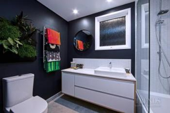 Resene Jaguar features in this contemporary bathroom, enhancing a black and white colour palette