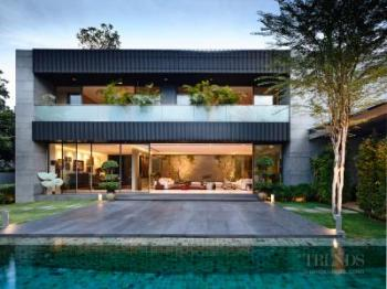 Modern family home in tropical climate has two wings and central courtyard