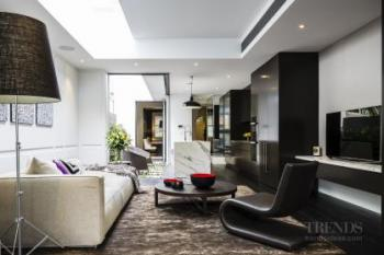 Classic terrace house exterior meets contemporary interior in this renovated entertainer's home