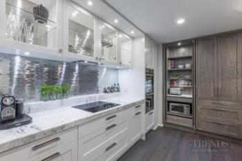 Eclectic kitchen with traditional doors and modern metal tile splashback