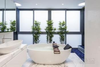 Contemporary pale bathroom with marble floor and water features