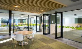 New nurses teaching facility with glass-walled adaptable classrooms