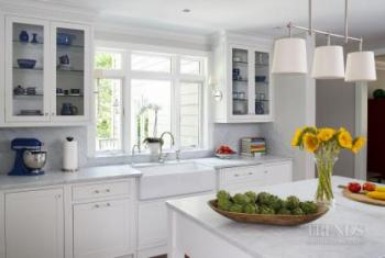 Traditional white kitchen with furniture-like island and wood floors. Image: 2