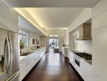 Traditional home renovation adds new floor level, sight lines and indoor-outdoor connections