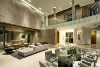 Large Hollywood home with limestone cladding and double-height entertaining spaces
