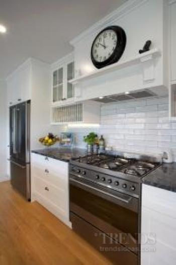 Traditional kitchen by Colleen Holder with Smeg appliances