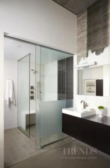 Industrial look bathroom combines rugged surfaces with minimalist aesthetic
