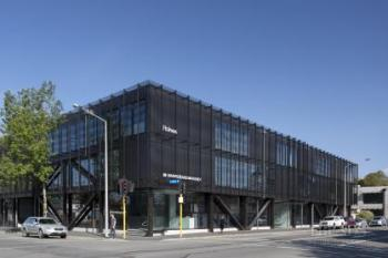 Contemporary new mixed-use building with exposed structural steel support