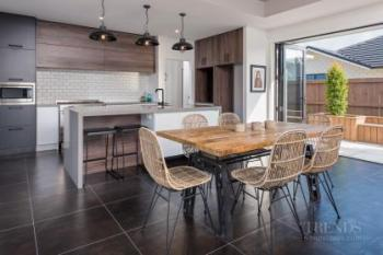 Industrial rustic show home by GJ Gardner