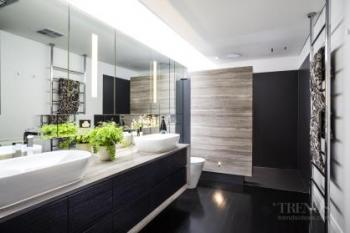 Luxury bathroom addition with Japanese wall tiles and marble shower