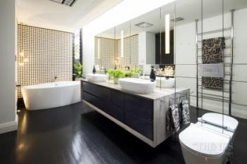 Minimalist luxury bathroom with Japanese wall tiles and marble shower