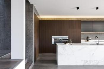 Huge wall tiles form the backdrop in this modern kitchen extension