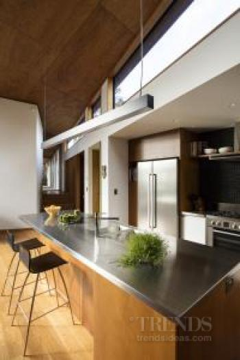 A variety of wood species feature in this new home and kitchen